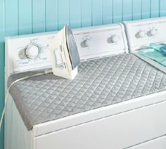 Dryer Top Ironing Pad.  Easier than dragging out the ironing board and it has a bigger area for ironing too.  Magnets keep it in place.