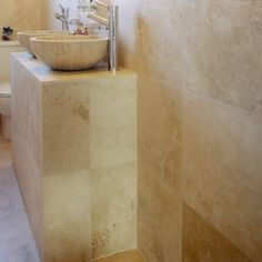 Light travertine bathroom wall