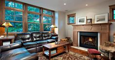 """This is the """"after"""" shot from home builders before and after gallery on their website. It's hard to see, but the ceiling slants toward the windows. This kind of place, with lots of wall space devoted to windows, would make a great reading room."""