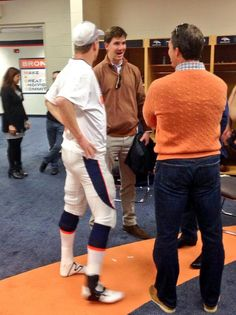 Eli celebrates with Peyton in locker room