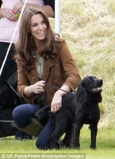 In need: Firefighters were called to the Middleton family home after Lupo, pictured here with Kate, got his head stuck in a gate