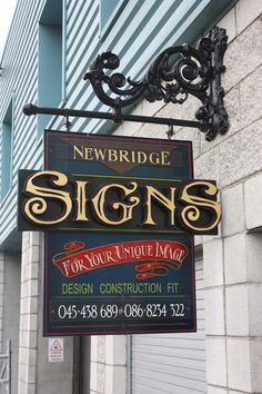 This is a combination of fret cut gold leaf and handpainted hanging sign in Naas co.Kildare