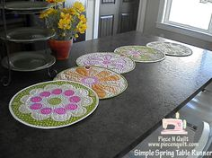 Moda Bake Shop -- Spring Table Runner & Placemats -- Isn't this cute?!  The instructions seem thorough enough that I might be able to make it.