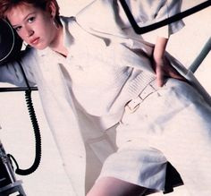 Molly Ringwald photographed by Oliviero Toscani for Mademoiselle magazine, March 1985. Clothing by Calvin Klein.