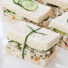 Wrapped like tiny gifts, our Herbed Chicken Salad Tea Sandwiches are the perfect finger food for a bridal or baby shower. Get the recipe with the link in our profile! #chickensalad #teatime #springrecipes #springentertaining