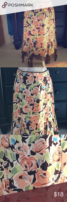 NICOLE MILLER FLORAL HANDKERCHIEF SKIRT 4 NICOLE MILLER FLORAL HANDKERCHIEF LINED SKIRT 4 MULTICOLORED IN BROWN, PALE PINK, BLUE AND IVORY.  GOOD CONDITION AND ZIPS AND HOOKS ON SIDE BUT THE HOOK IS MISSING THE LATCH. 100% SILK. Nicole Miller Skirts