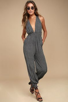 You'll be travel ready in a jiffy with the Take a Trip Black Print Halter Jumpsuit! Breezy, black and white print woven rayon falls from tying halter straps, into a plunging, backless bodice. Smocked waist provides a comfy fit above relaxed legs with tying ankle cuffs, and side seam pockets.