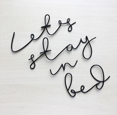 Handmade wire words 'let's stay in bed'. Picture Wire, Black Picture, Wire Wall Art, Command Hooks, Floating, Stay In Bed, Handmade Wire, Lead Time, A Table