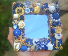 Handmade nautical jewelry mosaic mirror. Could use sea shells too. Make a photo frame.