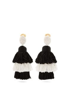 One of the best ways to finish your looks this season? It has to be with statement earrings, just like this Oscar de la Renta clip-on pair. White beads encapsulate the oval-shaped stud, while black and white tiered silk-satin tassel drops trail flamboyantly alongside the neck. Wear them to add a contemporary feel to romantic summer dresses.