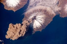 Mount Cleveland in Alaska's Aleutian Islands erupting, as seen from the International Space Station. The volcano reaches an elevation of 1,730 metres. Picture: NASA / SPL / Barcroft Media