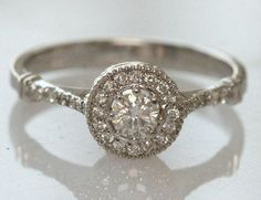 Vintage. I love this ring!! I would love a champaign or pink diamond or rose gold with white diamonds! engraving on the side