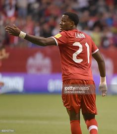 Cyle Larin of Canada speaks on the field during the World Cup 2018 football qualification match between Canada and El Salvador in Vancouver on...