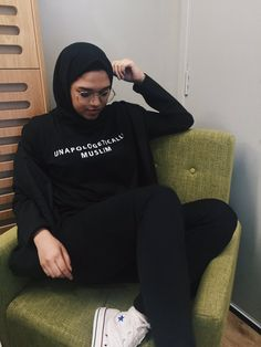 """Her shirt has a phrase commonly used by women who wear the hijab. Muslim women shouldn't be apologetic for not conforming to the """"normal"""" western standards of beauty. Modern Hijab Fashion, Street Hijab Fashion, Hijab Fashion Inspiration, Islamic Fashion, Muslim Fashion, Modest Fashion, Trendy Fashion, Modest Outfits, Fashion Outfits"""