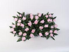Pink rosebud headstone spray/saddle arrangement from www.GravesideFlowers.com