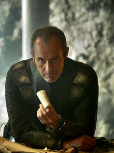 """Stannis, one recapper pointed out Stannis's growing frustration, """"Stannis seems to feel as though he has been staring at that damn painted table for years."""" the reminder of the kingdom he still can't rule and the throne he can't claim"""