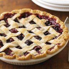 Adapt the filling for this pie recipe, which has a pretty lattice-strip crust topping, to suit seasonal availability and preferences. Make it with an assortment of berries.