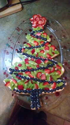 Christmas tree fruit pizza. Roll out any sugar cookie recipe into the shape you want. Mix 8 oz cream cheese and marshmallow fluff and spread over cookie. Cover with fruit of your choice.