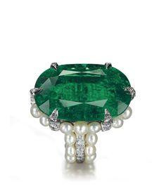 Emerald, pearl, and diamond ring in platinum setting, JAR Paris. Estimated worth: €390,000-540,000.