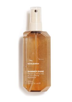 SHIMMER.SHINE  Revive shine and repair hair with this finishing mist. Treat your hair as it shines with Vitamins C and E, Baobab, Immortelle and Bamboo extracts. Light reflective technology from high-end skincare adds a brilliant shine to hair with no oily residue. SHIMMER.SHINE contains essential oils and vitamins that treat and repair damaged hair.