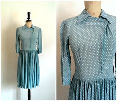 • Blue rayon with white polka dots day dress vintage from the 50s. Waisted waist, pleated flared skirt. Lightweight fabric. 3/4 sleeves. Waist darts. Original asymmetrical shirt collar. Metal zipper on the side. A hook and a small pressure to attach the neck.  • Brand: No brand,