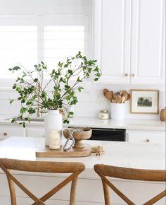 White cabinets, modern farmhouse kitchen, wood barstools, quartz countertops, gold hardware, home inspo,
