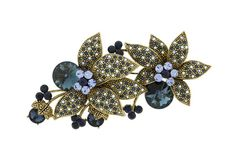 Flower Brooches Rhinestones and Cubic Zirconia Elements adorn the petals of the flower and Antique Gold metal base. Gorgeous montana, sapphire AB, and light sapphire crystal.