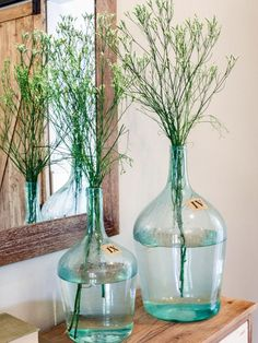 Wildflowers are beautiful, easy to find and, oh yeah, free, if you know where to look. Here, Joanna displayed them in vintage-style blue glass demijohn bottles.