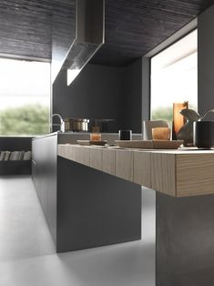 Innovative materials and design are at the core of Modulnova's mission. This Light #designkitchen presents base units and worktop in satin Cendre glass and an extending slatted peninsula top in Rovere Puro. #interiordesign #designhome #designinnovation http://www.modulnova.com/modern-kitchens/light-34