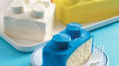 Building a birthday cake is fun and easy thanks to cake mix, ready-to-spread frosting and marshmallows.