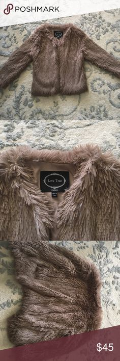 NWOT Fuzzy faux fur jacket!! NWOT fuzzy faux fur jacket!! So incredibly soft, perfect to throw over a dress when it's a little chilly!! Has placket!! It hits about 3/4 down the arm and about 3/4 on the waist!! No stains or smells! Smoke free home!! Jackets & Coats Blazers