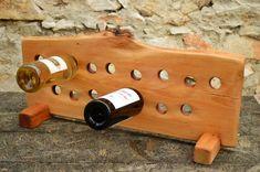 He encontrado este interesante anuncio de Etsy en https://www.etsy.com/es/listing/191658210/wooden-wine-rack-wooden-winery-beech