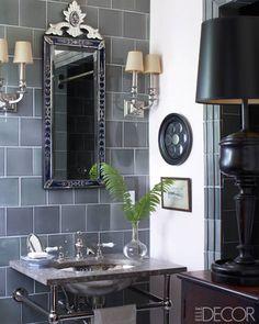 A 1920s Venetian mirror in a guest bath.