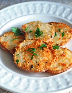 Parmesan Potato Rounds: 6 baby red potatoes, sliced into thin discs 1 Tablespoon all-purpose flour 1 Tablespoon grated Parmesan cheese 2 Tablespoons panko bread crumbs Salt and freshly ground black pepper Olive oil cooking spray Parsley, finely chopped