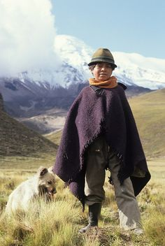 A young man and his dog guard the family sheep in an Andean valley below the summit of the Chimborazo volcano in Ecuador Ecuador, Mexico Culture, Quito, Fine Art Photography, Riding Helmets, Architecture Design, Leo, Concept, Country