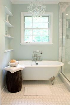 Add a little luxury to your small bathroom space by adding in a vintage chandelier and energy-efficient LEDs. paint color sherwin williams sea salt is one of the most popular green, blue, gray paint colour, good for a spa or beach theme bathroom or room Blue Green Paints, Green Paint Colors, Gray Green, Spa Colors, Grey Colors, Popular Paint Colors, Color Blue, Paint Colors For Living Room Popular, Beach Paint Colors