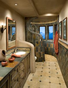 bathroom with brown tiles, different in shower area and sink area of Exquisite Bathroom Flooring Ideas