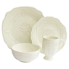 16-Piece Gabrielle Dinnerware Set in Cream - Create a chic tablescape for your next soiree with this elegant earthenware dinner set, featuring scalloped rims and a geometric textural motif.