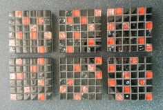 A set of 6 black and red crackle effect mosaic tile coasters. They are on sale on etsy with wendysworkshopGB for £20.