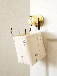great storage solutions for kids room organization // white dandelion toy storage basket for craft supplies