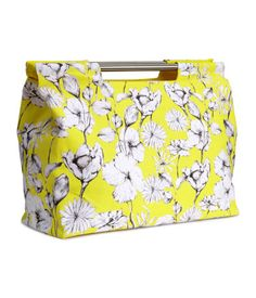 Yellow floral bag. I suspect the lack of a hands-free carrying option would eventually bug me, but the print and shape are great.