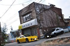 AE86 & RX7 in front of what used to be the Fujiwara Tofu Shop which was torn down in 2009.