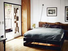 The bed was designed to hang from the ceiling and can be hoisted up and pulled down as needed.