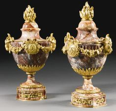 Auguste-Maximilien Delafontaine 1813-1892<br>A pair of Louis XVI style gilt-bronze mounted incarnat turquin marble urns and covers, Paris, last quarter 19th century