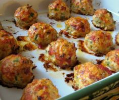 Baked Chicken Meatballs - 1 lb ground chicken, or 2 boneless skinless chicken breasts cut into strips and pulsed in a food processor until ground, 1 small yellow onion, diced, 1 clove garlic, minced, 3 strips bacon, diced, 1 egg yolk, 1 tablespoon extra virgin olive oil, 2 tablespoons tomato sauce, 3 tablespoons chopped Italian parsley. Going to try it without the bacon, much healthier, but drier.