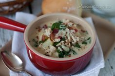 A lightened-up pressure cooker zuppa toscana - Olive Garden's popular soup made with sausage, potatoes, and spinach.