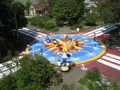 Paint your intersection. Residents in some neighborhoods have made them really worth stopping for. Some paint, creative people and a bright design are all it takes to bring neighbors together and produce something the whole community can be proud of.