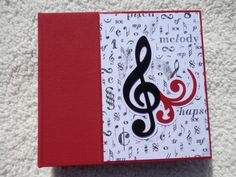 This is a 6x6 inch chipboard music themed scrapbook album which is the perfect way to preserve your memories of band, choir, or other musical