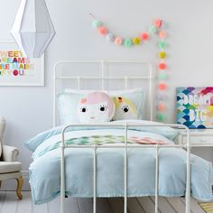 Colorful children's decor with vintage elements. Little girls room decorating inspiration.