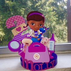 Doc Mcstuffins inspired Cake topper, centerpiece, cake topper, discount party supplies by NoStressPartyGoods on Etsy https://www.etsy.com/listing/225264649/doc-mcstuffins-inspired-cake-topper